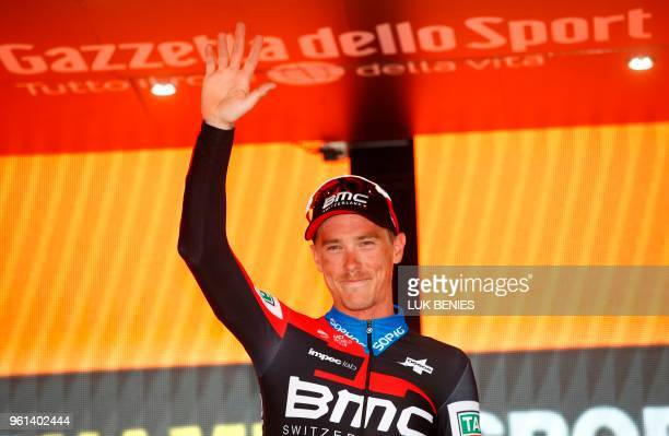 Australia's rider of team BMC Rohan Dennis celebrates on the podium after winning the 16th stage, a time trial between Trento and Rovereto, during...