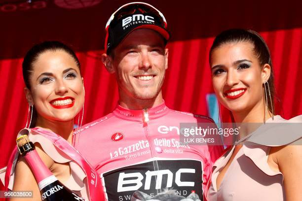 Australia's rider of team BMC Rohan Dennis celebrates the pink jersey of the overall leader on the podium after the 4th stage of the 101st Giro...