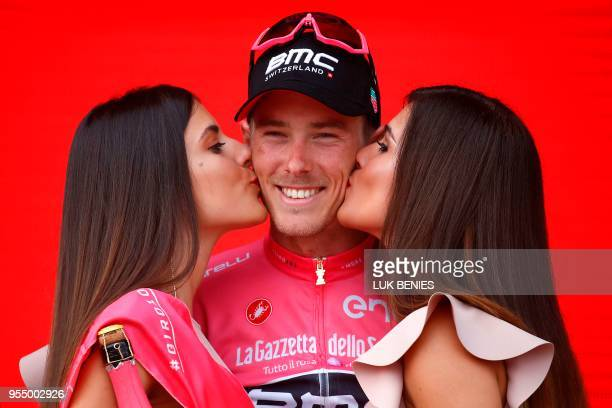 Australia's rider of team BMC Rohan Dennis wearing the overall leader's pink jersey celebrates on the podium after the 2nd stage of the 101st Giro...