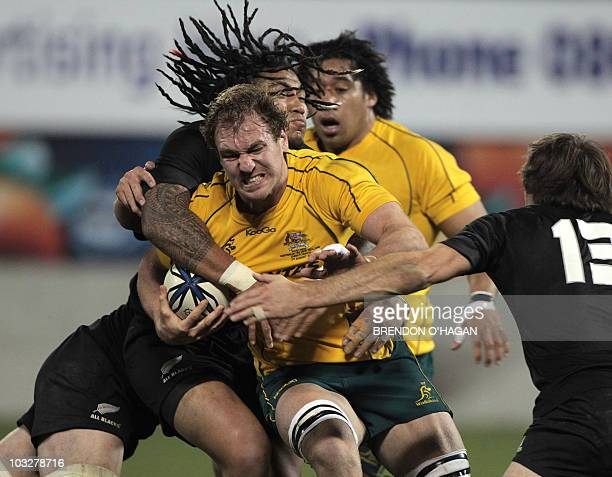Australia's Rocky Elsom is tackled by New Zealand's Ma'a Nonu during the TriNations rugby Test between New Zealand and Australia at AMI Stadium in...