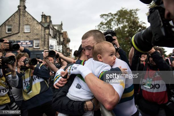 Australia's Rohan Dennis celebrates with his family after crossing the line to win the Elite Men Individual Time Trial, over 54 kms from...