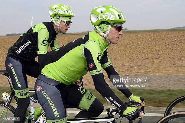 Australia's Rohan Dennis , wearing the best sprinter's green jersey, rides in the pack with his teammate of the USA's Cannondale-Garmin cycling team...