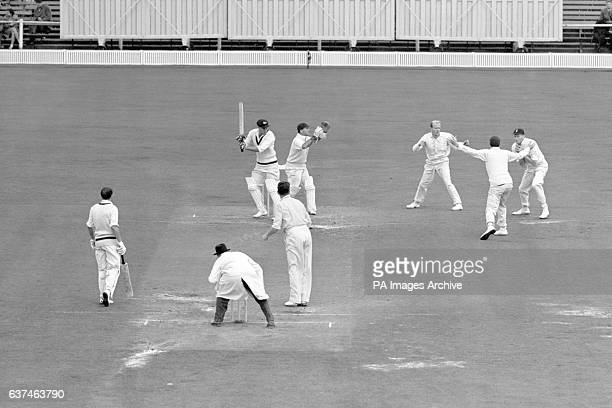 Australia's Ron Archer is caught by England's Alan Oakman off the bowling of Jim Laker