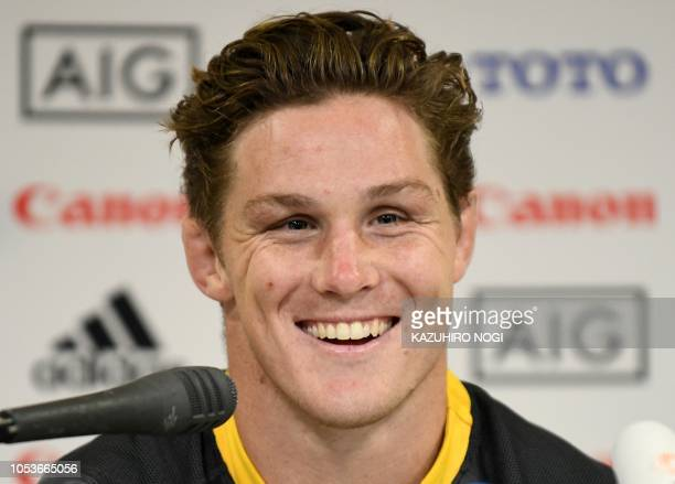 Australia's rugby captain Michael Hooper answers questions during a press conference following the Captain's run in Yokohama Kanagawa prefecture on...