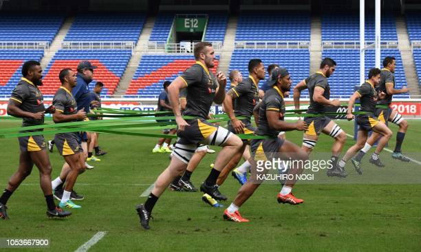 TOPSHOT Australia's rugby players work out during the Captain's run in Yokohama Kanagawa prefecture on October 26 ahead of their Bledisloe Cup match...