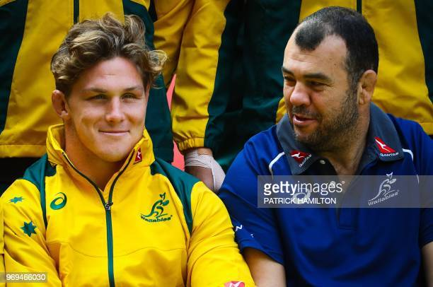 Australia's rugby team captain Michael Hooper and Australia's coach Michael Cheika attend the captain's run training session at Suncorp Stadium in...