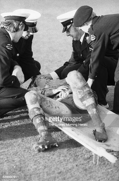 Australia's Russell Fairfax lies on a stretcher during the rugby union match between Australia and France at the Sydney Cricket Ground, 17 June 1972....