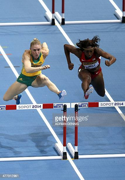 Australia's Sally Pearson and US Nia Ali compete in the Women 60 m Hurdles Final event at the IAAF World Indoor Athletics Championships in the Ergo...