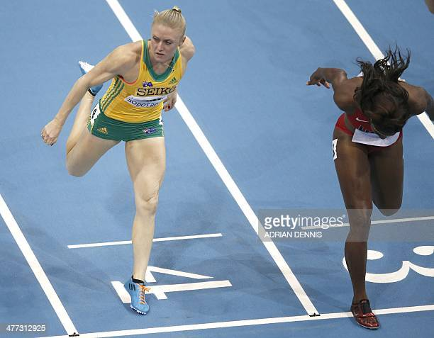 Australia's Sally Pearson and US Nia Ali cross the finish line in the Women 60 m Hurdles Final event at the IAAF World Indoor Athletics Championships...