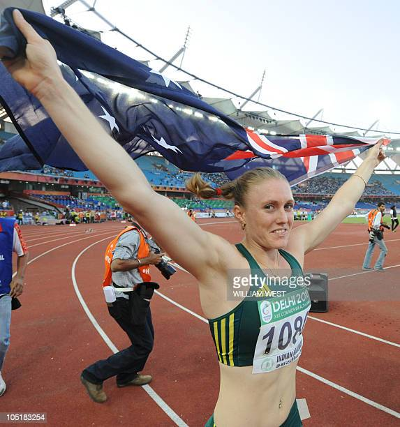 Australia's Sally Pearson celebrates her win in the the 100m hurdles women final of the Track and Field competition of the XIX Commonwealth Games on...
