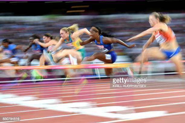 TOPSHOT Australia's Sally Pearson jumps a hurdle next to US athlete Kendra Harrison and Netherlands' Nadine Visser Germany's Pamela Dutkiewicz US...