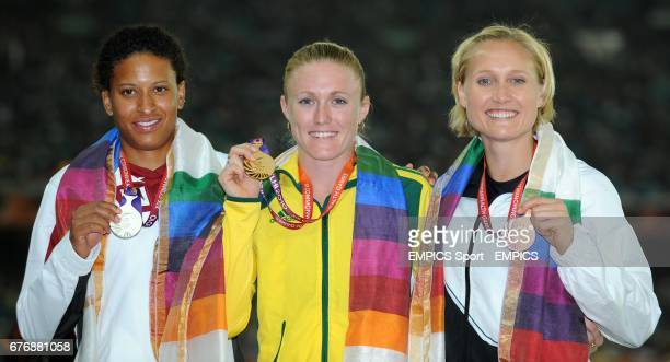 Australia's Sally Pearson with here gold medal next to Silver medallist Canada's Angela Whyte and Bronze medallist New Zealand's Andrea Miller after...