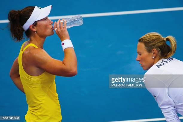 Australia's Sam Stosur listens to Australian team captain Alicia Molik during during a break between games again Germany's Angelique Kerber in the...