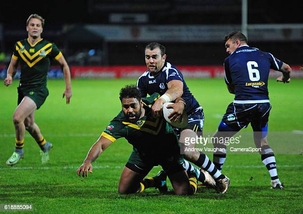 Australia's Sam Thaiday is tackled by Scotland's Kane Linnett during the Four Nations match between the Australian Kangaroos and Scotland at...