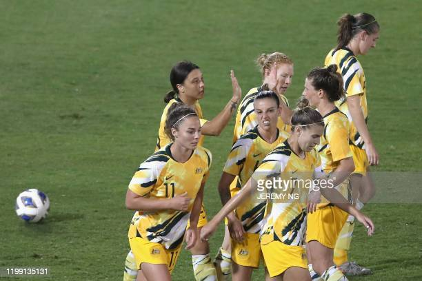 Australia's Samantha Kerr celebrates her goal with her teammates during the women's Olympic football tournament qualifier match between Taiwan and...