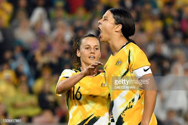 Australia's Samantha Kerr shouts after scoring a penalty kick during the women's Olympic football tournament qualifier match between Australia and...