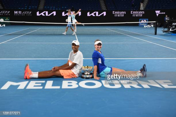 Australia's Samantha Stosur and partner Australia's Matthew Ebden gesture as Czech Republic's Barbora Krejcikova and partner Rajeev Ram of the US...