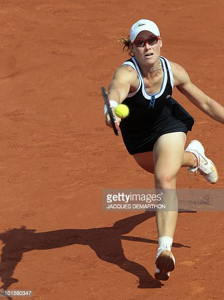 Australia's Samantha Stosur plays a return during her women's quarter-final against US Serena Williams in the French Open tennis championship at the...