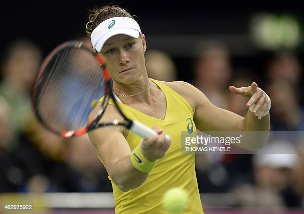 Australia's Samantha Stosur returns to Germany's Angelique Kerber during their match of the FedCup World Group quarterfinal between Germany and...