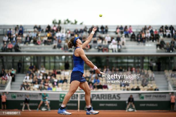 Australia's Samantha Stosur serves the ball to Russia's Ekaterina Alexandrova during their women's singles second round match on day five of The...