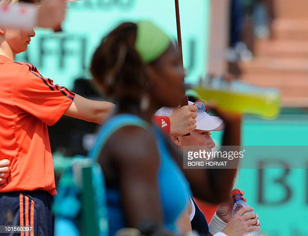 Australia's Samantha Stosur takes a drink during her women's quarter-final against US Serena Williams in the French Open tennis championship at the...