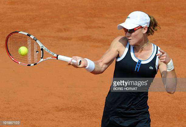 Australia's Samatha Stosur plays a return to US Serena Williams plays during their women's quarter-final match in the French Open tennis championship...
