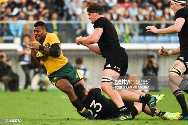 Australia's Samu Kerevi is tackled by New Zealand's Anton LienertBrown during the Bledisloe Cup rugby union Test match between the New Zealand All...
