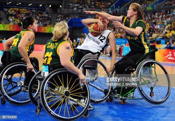Australia's Sarah Stewart plays tough defense on Germany's Meren Butterbrodt as Clare Burzynski and Kylie Gauci watch in their women's wheelchair...