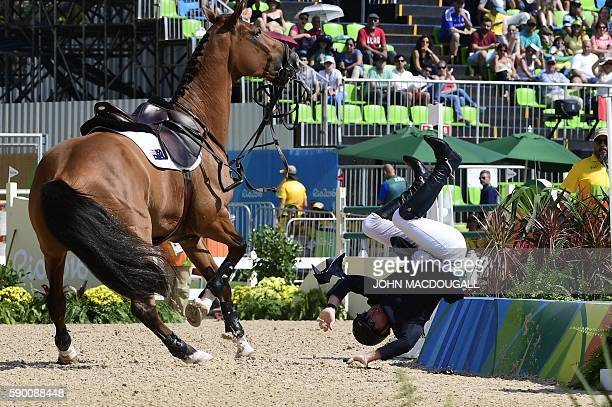 Australia's Scott Keach riding Fedor falls during the Equestrian Jumping Inividual qualifications at the Olympic Equestrian Center during the Rio...