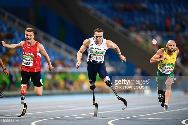 TOPSHOT Australia's Scott Reardon Denmark's Daniel Wagner and the UK's Richard Whitehead compete in the 100M during the Paralympic Games in Rio de...