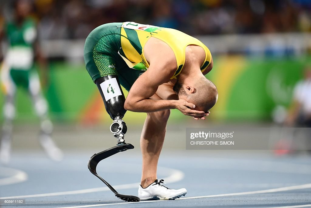 TOPSHOT - Australia's Scott Reardon reacts after winning the 100M during the Paralympic Games in Rio de Janeiro, Brazil on September 15, 2016. / AFP / CHRISTOPHE