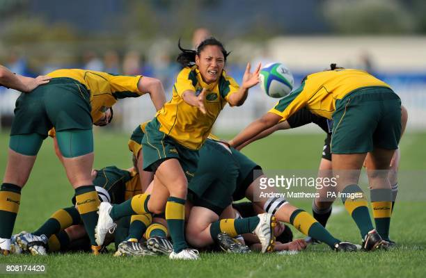 Australia's scrum half Cheryl Soon offloads the ball from the back of a ruck during the IRB Women's World Cup match at Surrey Sports Park Guildford