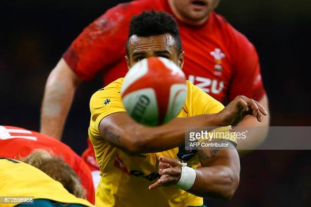 TOPSHOT Australia's scrumhalf Will Genia releases the ball during the rugby union international Test match between Wales and Australia at the...