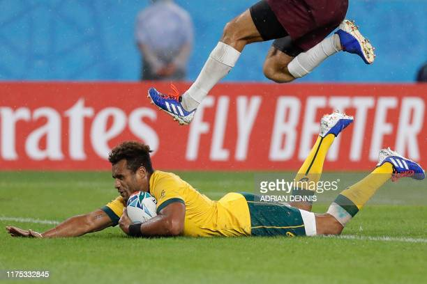 Australia's scrum-half Will Genia scores a try during the Japan 2019 Rugby World Cup Pool D match between Australia and Georgia at the Shizuoka...