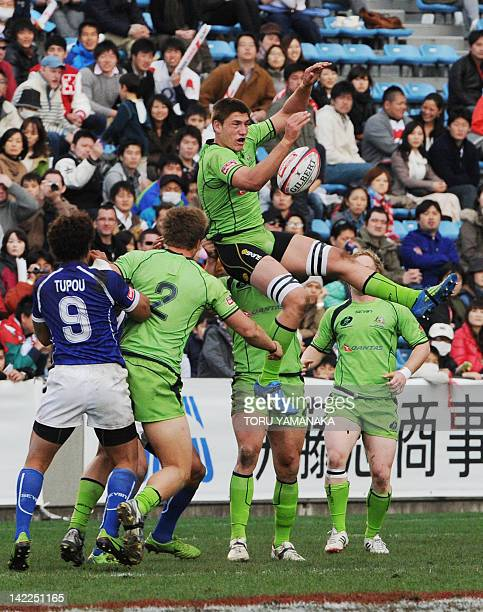 Australia's Sean Mcmahon tries to keep the ball in the air during the final mach against Samoa in the 2012 Tokyo Sevens World Series rugby tournament...