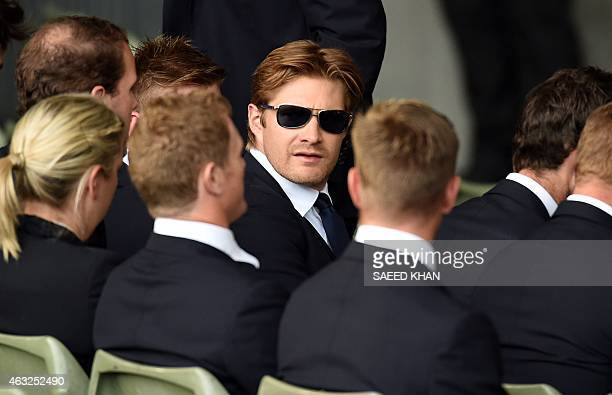Australia's Shane Watson talks to his teammates during the opening ceremony of the ICC 2015 Cricket World Cup at the Myer Music Bowl in Melbourne on...