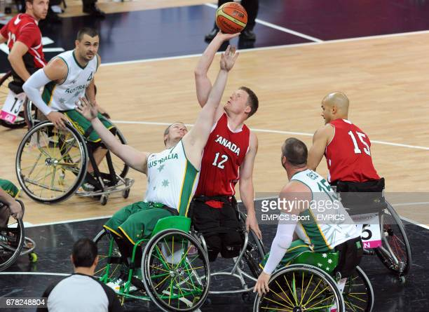 Australia's Shaun Norris and Canada's Patrick Anderson compete for possession during the men's wheelchair basketball final between Australia and...