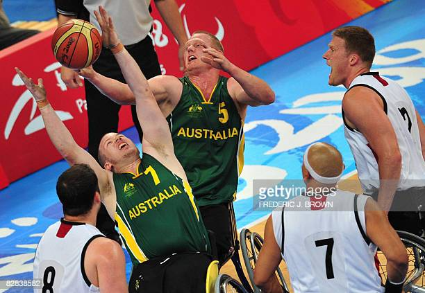 Australia's Shaun Norris and Troy Sachs win the battle for the rebound with Canada's Joey Johnson Richard Peter and Patrick Anderson in their men's...