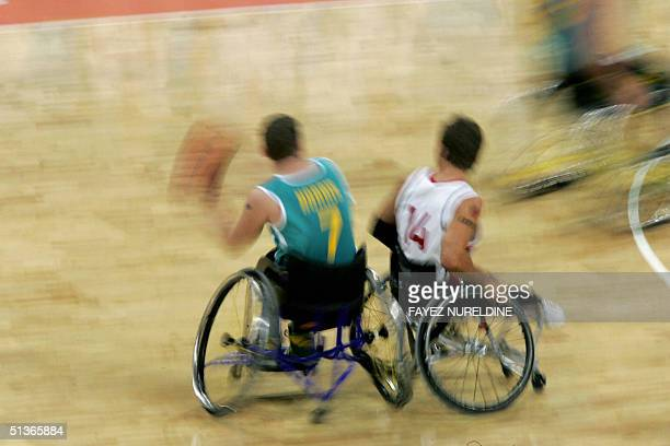 Australia's Shaun Norris dribbles past Canada's Travis Gaertner during the final of the Paralympic wheelchair basketball in the Olympic Indoor Hall...