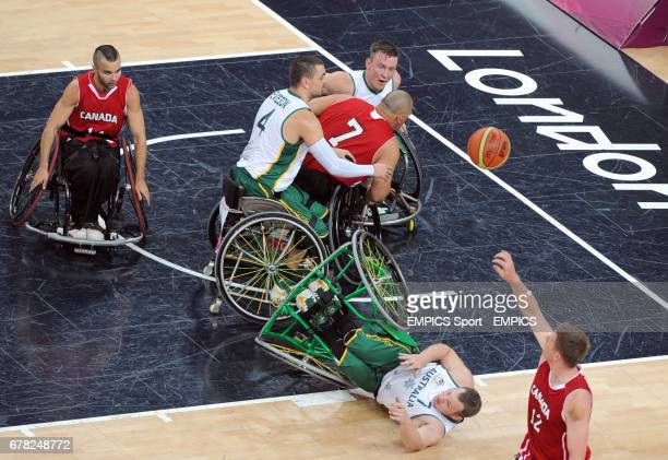Australia's Shaun Norris falls over during the men's wheelchair basketball final between Australia and Canada at the North Greenwich Arena London