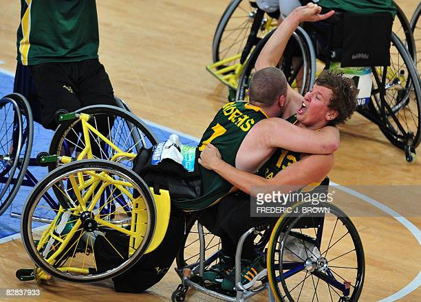 Australia's Shaun Norris leans on a gesturing Dylan Alcott as players celebrate victory over Canada in their men's wheelchair basketball gold medal...