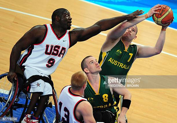 Australia's Shaun Norris looks to shoot under pressure from Matt Scott of the US as Michael Hartnett and Jeremy Lade guard in their men's wheelchair...
