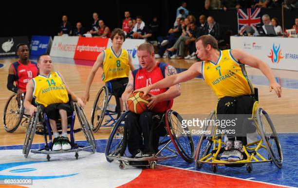 Australia's Shaun Norris tries to steal the ball from Great Britain's Peter Finbow during their wheelchair basketball match