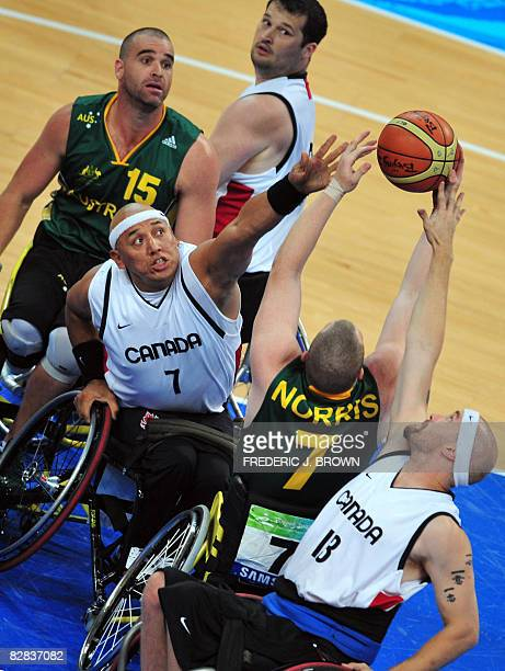 Australia's Shaun Norris vies for the rebound with Canada's Richard Peter and Chris Stoutenberg as Joey Johnson and Brad Ness look on in their men's...