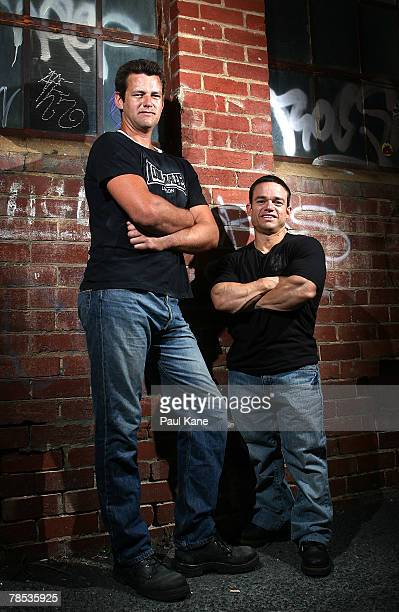 Australia's shortest competitive male bodybuilder David Clarke poses with his brother Paul near in a central Perth laneway on November 10 2007 in...