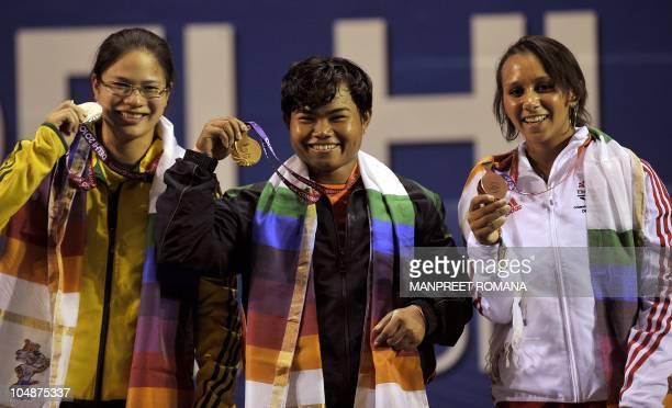 Australia's silver medal winner Seen Lee India's gold medal winner Renu Bala Chanu Yumnam and England's bronze medal winner Zoe Smith pose together...