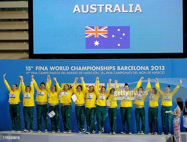 Australia's silver medal winning team celebrate on the podium after losing the women's water polo gold medal final match between Australia and Spain...