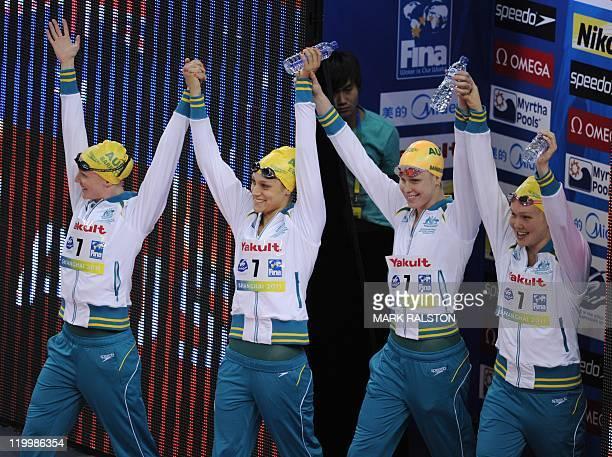 Australia's silver medalists Kylie Palmer Australia's Bronte Barratt Australia's Angie Bainbridge and Australia's Blair Evans hold hands on the...