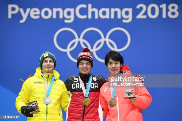 Australia's silver medallist Matt Graham Canada's gold medallist Mikael Kingsbury and Japan's bronze medallist Daichi Hara pose on the podium during...