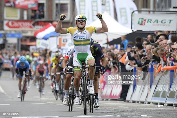 Australia's Simon Gerrans celebrates as he crosses the finish line and wins the 100th edition of the LiegeBastogneLiege oneday classic cycling race...
